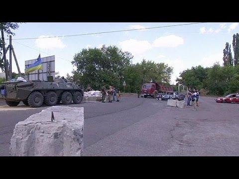Ukraine military encircles rebel-held Donetsk