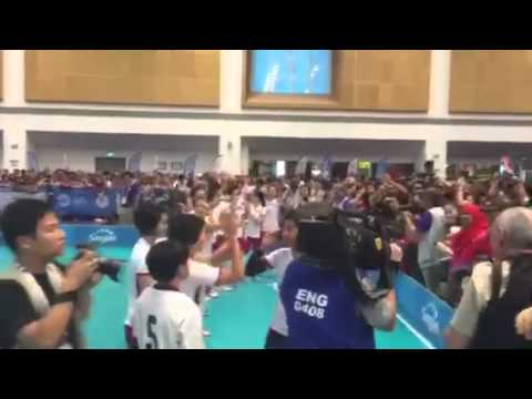 Singapore's women floorball players acknowledging the crowd after their win