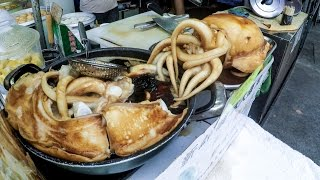 Hong Kong Food, Cooking the Cuttlefish. A Street Food Delicacy of Tai O Village
