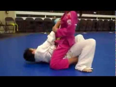 girl submits boy bjj training mixed fight Image 1