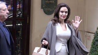 A Lister Angelina Jolie gets swarmed by a massive crowd of fans in Paris