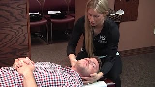 Spinal Adjustment: Back Pain Treatment at West End Chiropractic (Female Doctor, Male Patient)