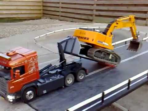 YouTube- Scania R620 Unloading Liebherr 944.mp4