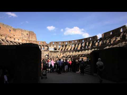 ROME - CIRCA MAY Tourists survey the ruined arena of the Colosseum circa May 2012 in Rome, Italy.