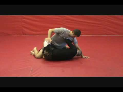 Establishing X Guard from Half Guard Image 1