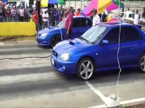 05 Subaru Impreza WRX Powered by HKS GT-RS vs another modified WRX, Turbo Civic. Pista De Leo en Acarigua 1ro de Mayo 2011, Piques Barquisimeto Redline.