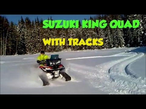 Suzuki King quad 500 4x4 ATV with Camoplast tatou 4s snow tracks...
