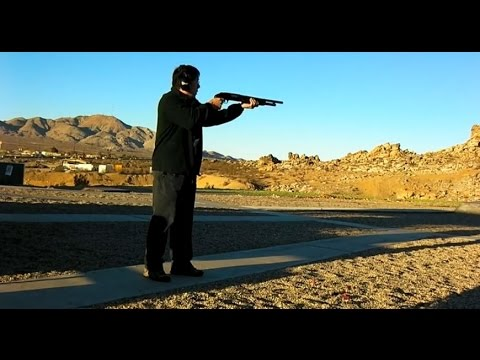 Shooting Mossberg 500 12-gauge Pump Shotgun With Hogue