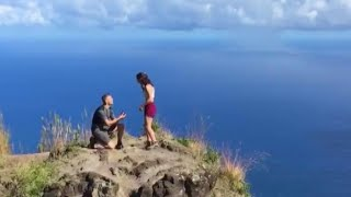 Couple Engaged on Cliff Searching For Person Who Recorded It