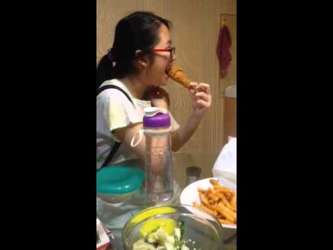 Chinese girl eating fried chicken