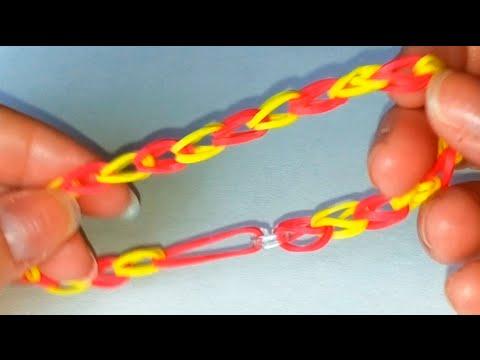 Видео как плести из резинок браслеты легкие