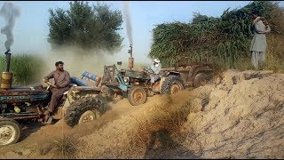 Tractor stuck in sand badly position ford 3610  Maiz Loaded Trailer/rescu ford 4600 & ford 4000