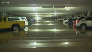Cars submerged at Dallas Love Field parking garage after heavy rainfall