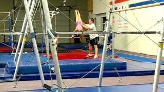 Teagan attempting giant on bars