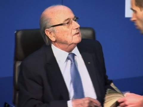 Man Throws Stack of Cash at FIFA's Sepp Blatter