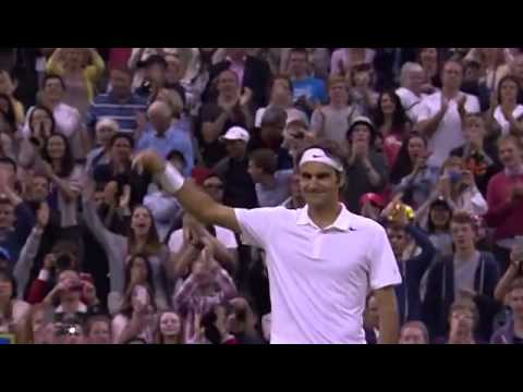 Federer enjoys the win v Muller - Wimbledon 2014