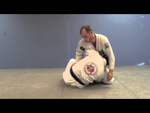 Deep Half Guard Entry from 1000 Jiu-Jitsu Techniques- www.jiujitsulife.com Image 1