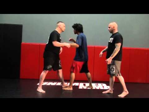 Muay Thai Striking Techniques - Elbow Strike From Over Under Position  - MMA Moves Image 1