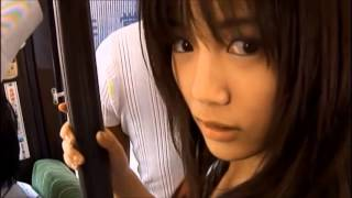 a Japanese school girl   frightened by         in a bus