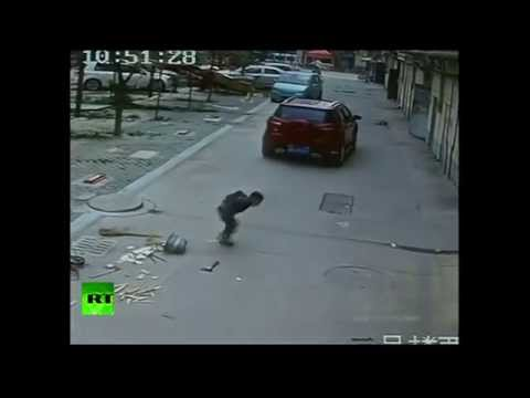 Miracle! China Boy Run Over By Car, Stands Up, Walks Away video