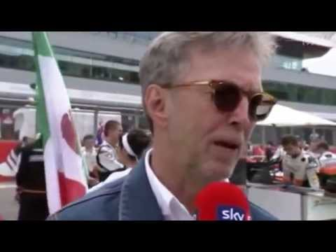 Eric Clapton with his wife Melia - Grid Walk with Martin Brundle F1 2014 British GP - Pre - Race