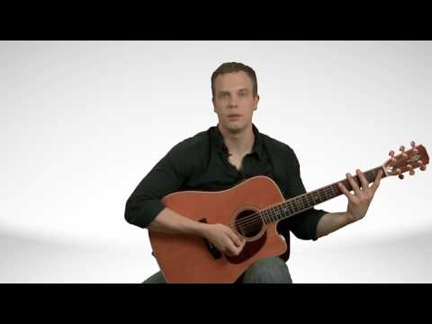 How To Hold An Acoustic Guitar - Guitar Lessons