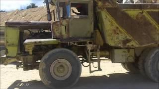 Euclid Dump Trucks Jake Braking Down Hill At Quarry