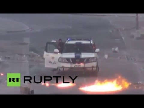 Bahrain: Police cars burn as protesters clash after demo crackdown