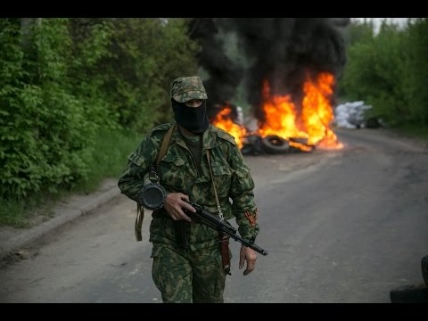 Ukraine refugee convoy hit by rockets, says military