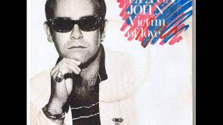 Watch Elton John Victim Of Love video