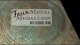 Faux metal medallion with verdigris patina