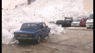 Russian Avalanche Slowly Crushes Cars