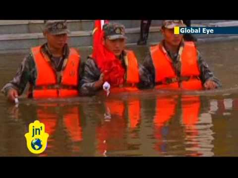 Flooding fails to prevent Chinese flag-raising: Major floods cut troops off on Chinese border island
