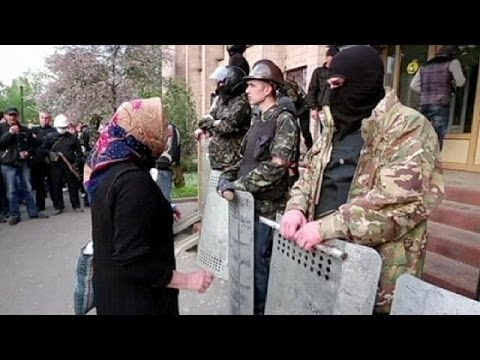 Gun shots heard and more government buildings seized in east Ukraine