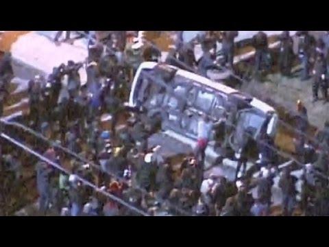 Ferguson protesters flip police car outside city hall