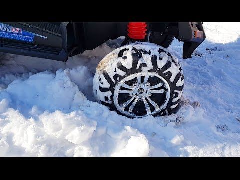 The Car stuck in the snow Dima Ride on POWER WHEEL Tractor to help woman