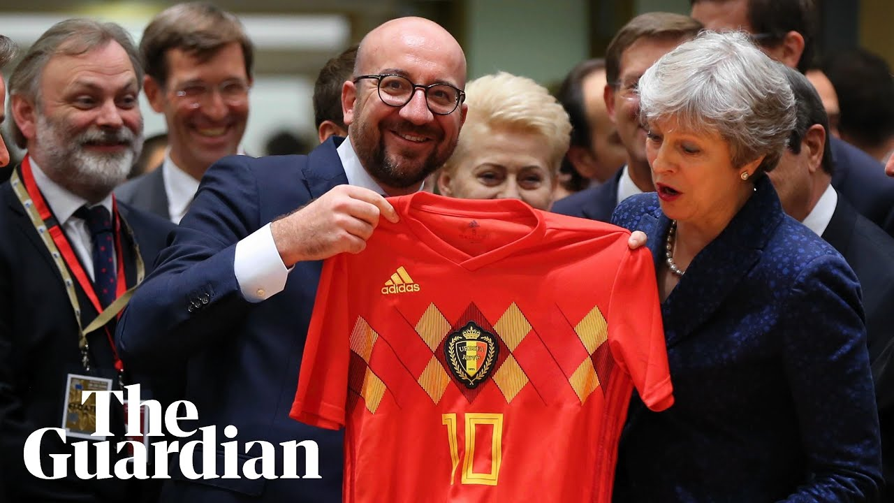 May receives footballer Eden Hazard's shirt from Belgian PM