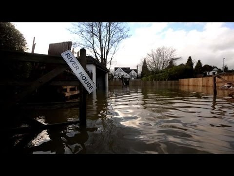 Britain's River Thames on flood alert as blame game rages