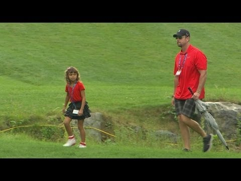 In the final round of the 2013 Deutsche Bank Championship, Tiger Woods' daughter Samantha walks along to watch him play his final holes following a weather d...