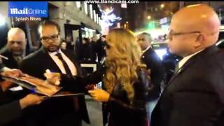 Mariah Carey signs autographs for adoning fans outside NY show