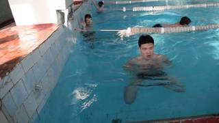 TREAD WATER FOR 2MIN. USING ONLY LEGS.