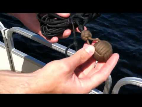 Paracordist how to throw a quick coil paracord monkeys fist lifeline from a boat - HD