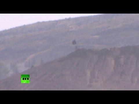 Black flag over Kobane - ISIS battles on Turkey-Syria border