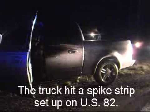 A pursuit for a speeding pick-up truck ended about 10 p.m. Monday, May 21, 2012 on the outskirts of Magnolia, Arkansas, after the driver hit a spike strip an...