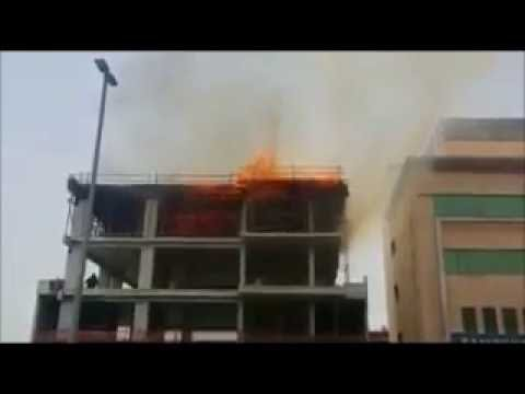 Fire erupts at a building under construction in Port Saeed - GULF NEWS