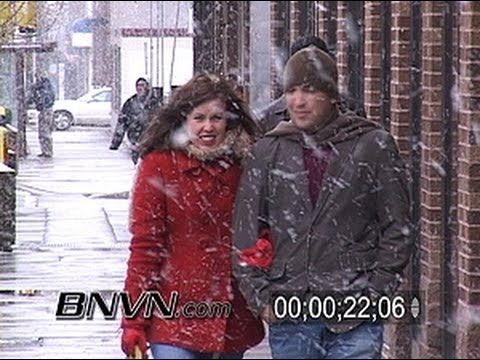3/11/2005 People and traffic in heavy snow news video stock footage
