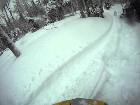 Uncle Joe just got unstuck.... Rangeley, ME snowmobiling 2010