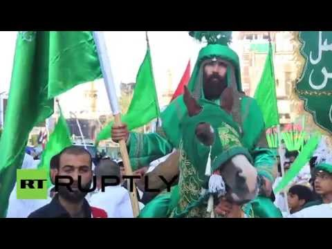 Video ID: 20141102-004   W/S Pilgrims in street  M/S A pilgrim on horseback  W/S Pilgrims in street  C/U Young child  W/S People near Shrine of Hussein ibn Ali  W/S Shrine of Hussein ibn Ali  W/S People in street  M/S Drummers  M/S Procession  M/S Man in procession  W/S Procession  M/S Procession  W/S A group of pilgrims  M/S People playing instruments in procession  M/S People playing instruments in procession  W/S Procession  C/U Drummer  M/S Flagellates marching  W/S Shrine of Hussein ibn Ali  SCRIPT  Millions of pilgrims from around the world poured into the Iraqi city of Karbala Saturday to mark Ashura, one of the most important holidays for Shiite Muslims.  For Shiites, Ashura marks the death of Imam Hussein, a grandson of the Prophet Muhammad who was martyred in 680 AD in the Battle of Karbala. Sunnis refer to Ashura as the \