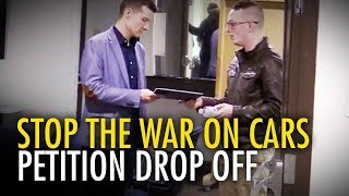 Stop the War on Cars petition delivered to Calgary Councillor