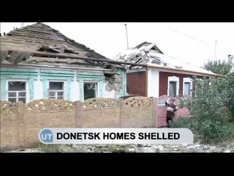 Ukrainian Homes Shelled Amid Ceasefire: East Ukrainian residents survey damage to properties